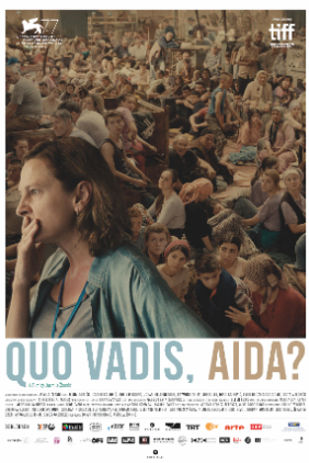 Poster showing Aida in front of a warehouse of refugees.